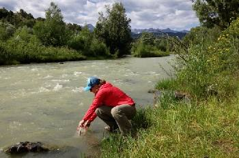 Collecting emergency drinking water from a stream.