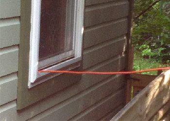 Run the generator outside then run extension cord inside.