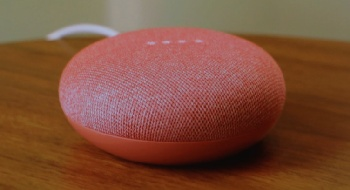 The Google Home Mini, in coral