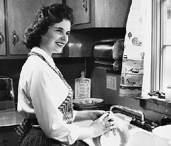 1950s Mom washing the dishes by hand.