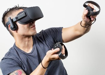 This gamer is decked out in full Oculus Rift VR gear.
