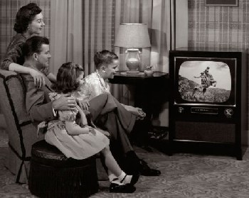 1950s family watching black-and-white TV.