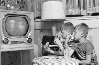 Boys watching old black and white TV 1960s