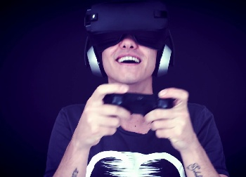 Man amazed by virtual reality goggles.