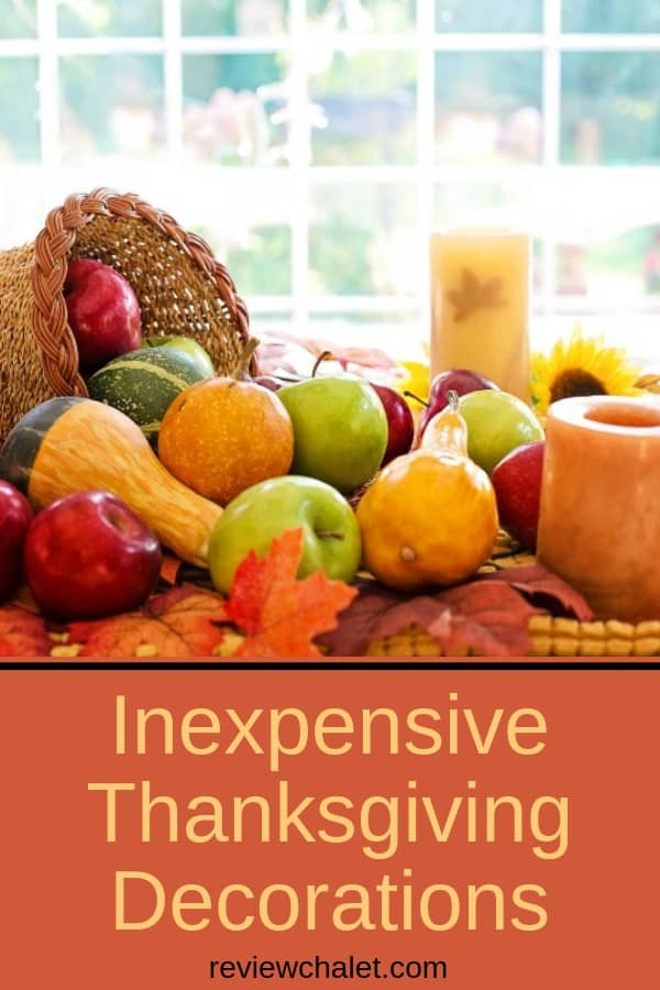 Need some inexpensive Thanksgiving decorations? Here are a few ideas to get you inspired. From crunchy leaves you can find in your backyard to paper pumpkins, and fall candles, you'll find an idea that's perfect for your home. #thanksgiving #thanksgivingdecorations #inexpensivehomedecor #holidaydecorations #rch