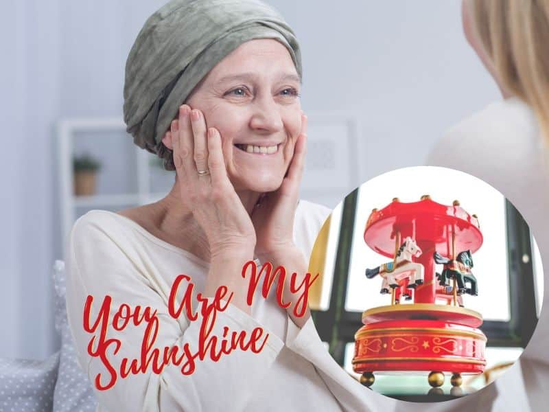 Mother and daughter sharing a sweet moment and a music box playing you are my sunshine